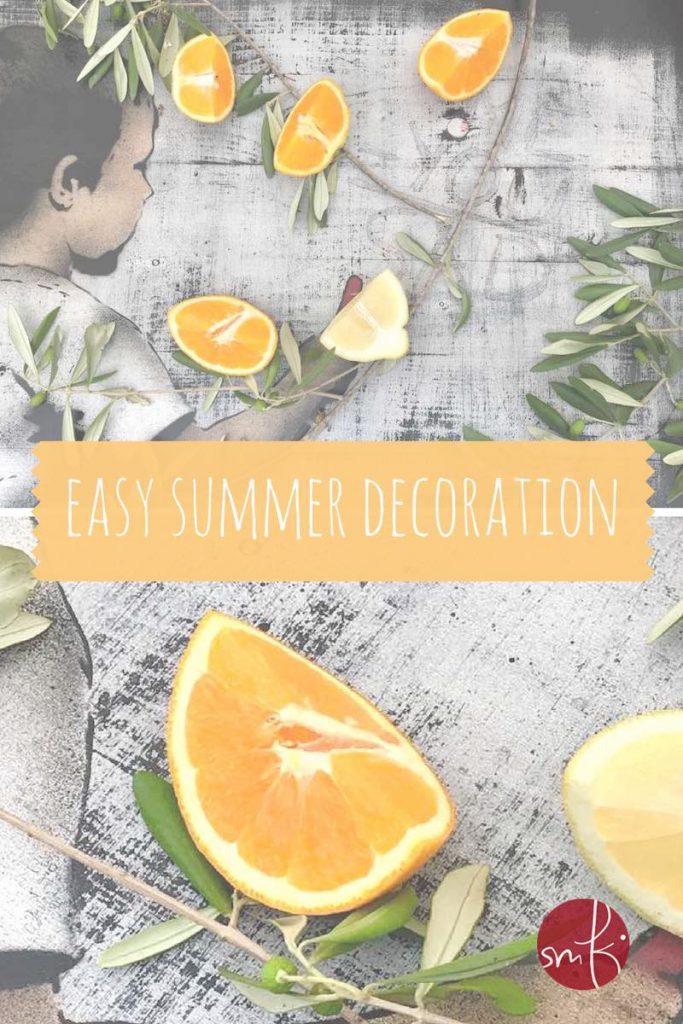 Easy Tischdeko wie im sonnigen Süden: mit Olivenzweigen, Orangen und Zitronen